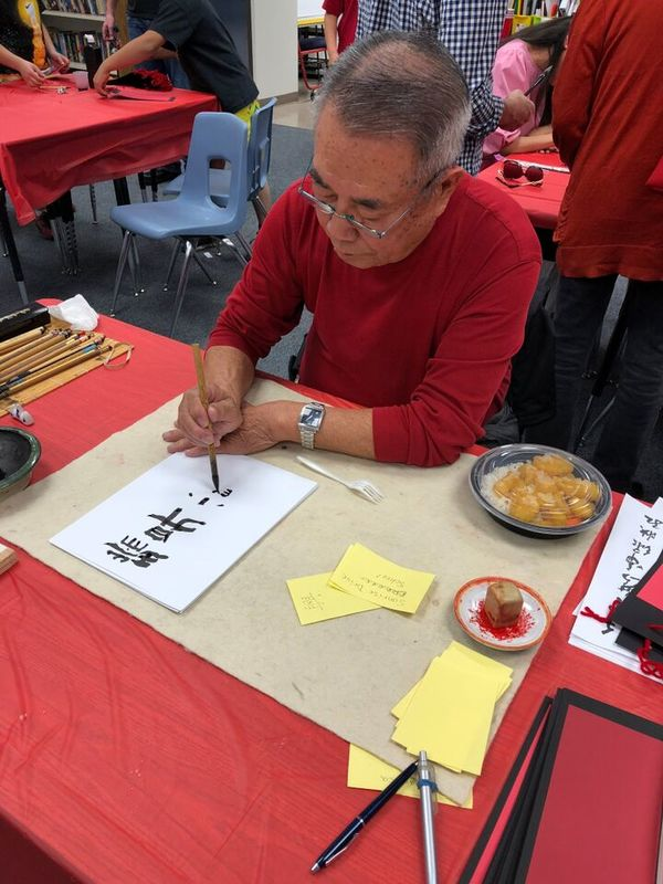 Chinese calligrapher writing.